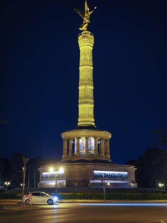 Angel statue aka Siegessaeule (meaning Victory Column) in Tiergarten park in Berlin, Germany at night