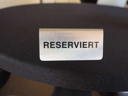 Reserviert (meaning Reserved in German) sign on a restaurant table