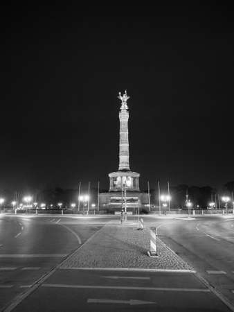 Angel statue aka Siegessaeule (meaning Victory Column) in Tiergarten park in Berlin, Germany at night in black and white Banco de Imagens