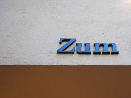 Zum (contraction of Zu dem) German proposition and article meaning To the