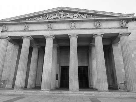 Neue Wache (meaning New Guardhouse) Central Memorial of the Federal Republic of Germany for the Victims of War and Dictatorship in Berlin, Germany in black and white