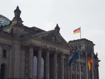 Bundestag German Houses of Parliament in Berlin, Germany. Dem deutschen Volke means To the German people