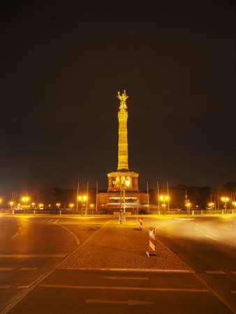 Angel statue aka Siegessaeule (meaning Victory Column) in Tiergarten park in Berlin, Germany at night