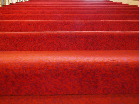 stairs with red carpet fabric useful as a background 스톡 콘텐츠 - 124985510
