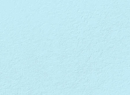 delicate light blue stucco wall useful as a background Stock Photo