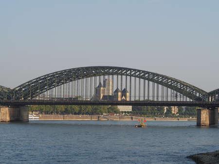 Hohenzollernbruecke (meaning Hohenzollern Bridge) crossing the river Rhein in Koeln, Germany