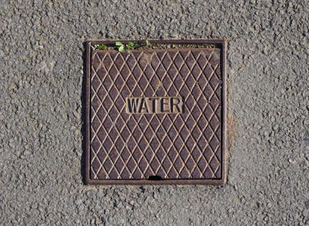 detail of a water service manhole in the roadway