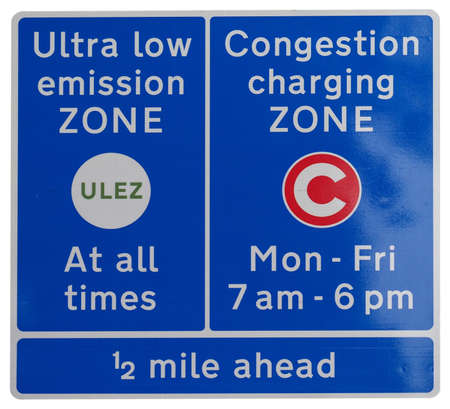 ULEZ (Ultra low emission zone at all times) and C (Congestion charging zone) signs in London, UK isolated over white background