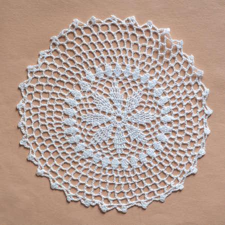 white decorated ornamental doily in white fabric 版權商用圖片