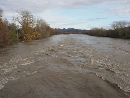 Large river flood with muddy water waves