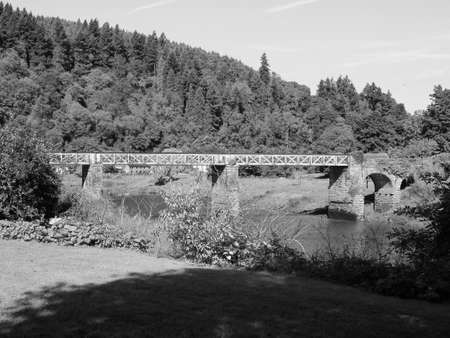 River Wye (Afon Gwy in Welsh) marks the border between England and Wales in Tintern, UK in black and white