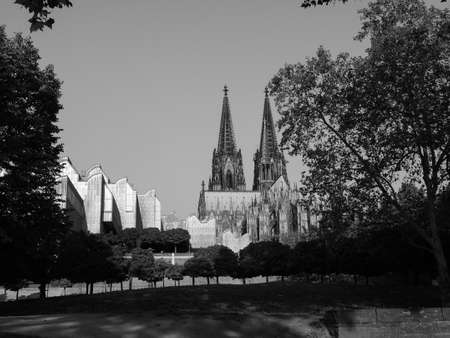 Koelner Dom Hohe Domkirche Sankt Petrus (meaning St Peter Cathedral) gothic church in Koeln, Germany in black and white