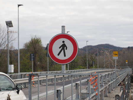 Regulatory signs, no pedestrians traffic sign by a flooded river