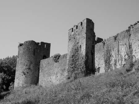 Ruins of Chepstow Castle (Castell Cas-gwent in Welsh) in Chepstow, UK in black and white Éditoriale