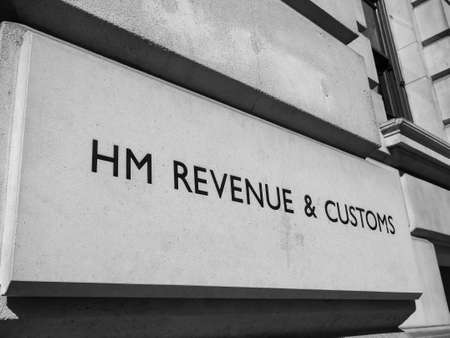 HMRC (Her Majesty Revenue and Customs) sign in London, UK in black and white Reklamní fotografie