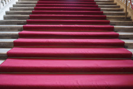 Red carpet on a stairway used to mark the route on ceremonial and formal occasions or events