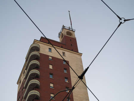 Torre Littoria skyscraper in Piazza Castello behind tramway wires in Turin, Italy