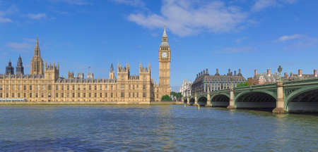 High resolution panoramic view of the Houses of Parliament Big Ben and Westminster Bridge seen from river Thames of London, UK