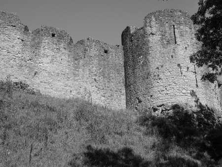 Ruins of Chepstow Castle (Castell Cas-gwent in Welsh) in Chepstow, UK in black and white Reklamní fotografie