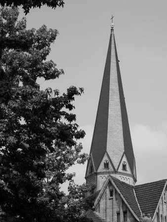Bonner Muenster (meaning Bonn Minster) basilica church steple in Bonn, Germany in black and white