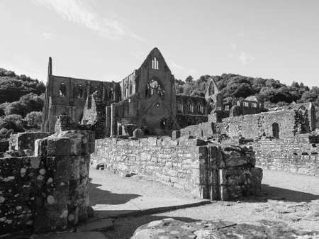 TINTERN, UK - CIRCA SEPTEMBER 2019: Tintern Abbey (Abaty Tyndyrn in Welsh) ruins in black and white