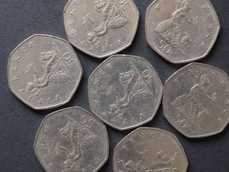 50 pence coin money (GBP), currency of United Kingdom
