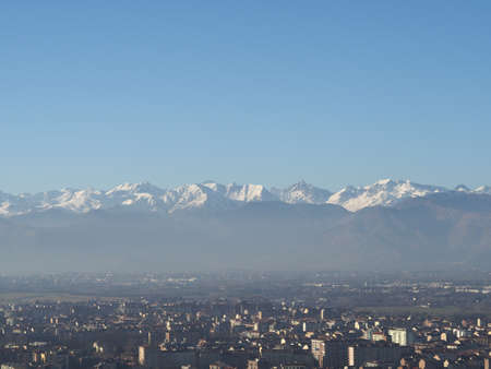 Aerial view of the city of Turin, Italy with Alps mountain range in the background