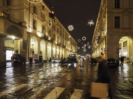TURIN, ITALY - CIRCA DECEMBER 2019: Night view of Via Po street