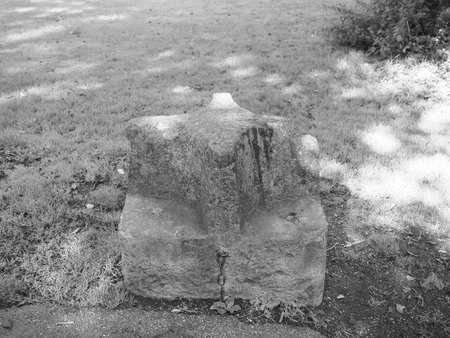 Carved stone seat presented to mark the Diamond Jubilee of Queen Victoria by stonemason John Hobbs in 1897 in Chepstow, UK in black and white