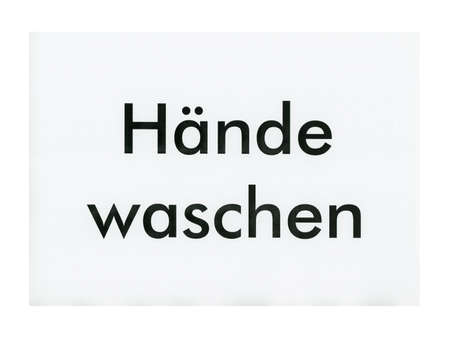 Makeshift haende waschen (translation: wash your hands) sign printed on A4 sheet