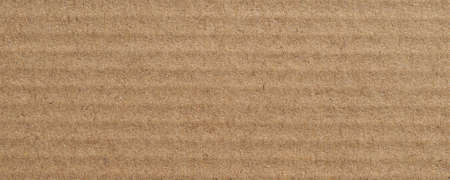 wide grunge brown corrugated cardboard texture useful as a background