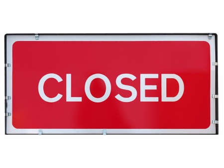 Closed sign a in shop window isolated over white background
