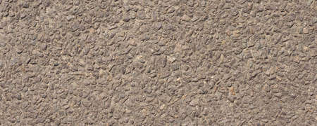 wide Brown concrete gravel aggregate pavement useful as a background