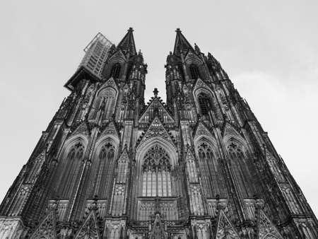 Koelner Dom Hohe Domkirche Sankt Petrus (meaning St Peter Cathedral) gothic church in Koeln, Germany in black and white Reklamní fotografie