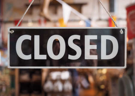 Closed sign in a shop window with reflections Stock Photo