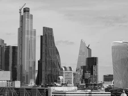 LONDON, UK - CIRCA SEPTEMBER 2019: View of the City of London skyline in black and white