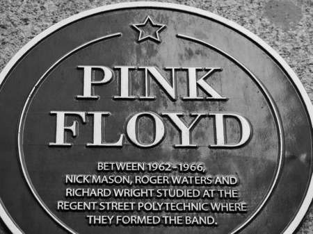 LONDON, UK - CIRCA SEPTEMBER 2019: Pink Floyd plaque at Regent Street Polytechnic where they studied and formed the band in black and white Sajtókép