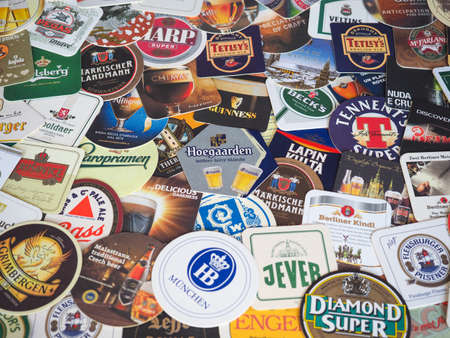 LONDON, UK - MARCH 10, 2020: Beer mats of many different brands