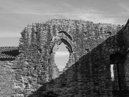 TINTERN, UK - CIRCA SEPTEMBER 2019: Tintern Abbey (Abaty Tyndyrn in Welsh) ruins in black and white Foto de archivo