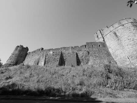 Ruins of Chepstow Castle (Castell Cas-gwent in Welsh) in Chepstow, UK in black and white Foto de archivo