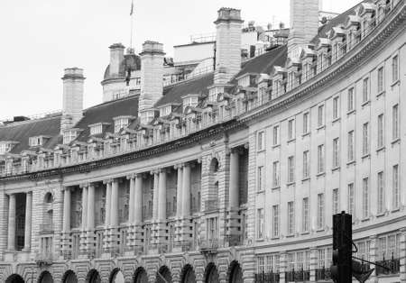 LONDON, UK - CIRCA SEPTEMBER 2019: People in Regent Street crescent in black and white