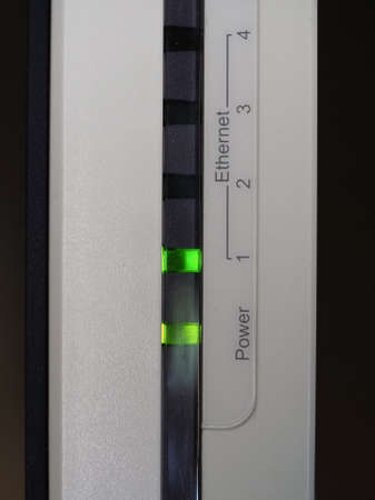 Ethernet and power green led on a modem router