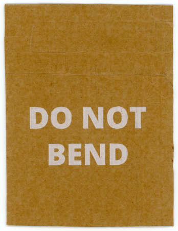 do not bend written on brown corrugated cardboard packet 스톡 콘텐츠