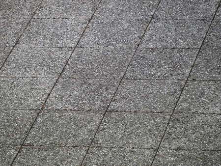 grey tiled concrete floor useful as a background 스톡 콘텐츠