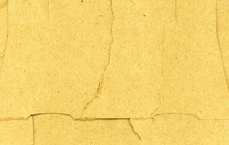 yellow brown cardboard texture useful as a background