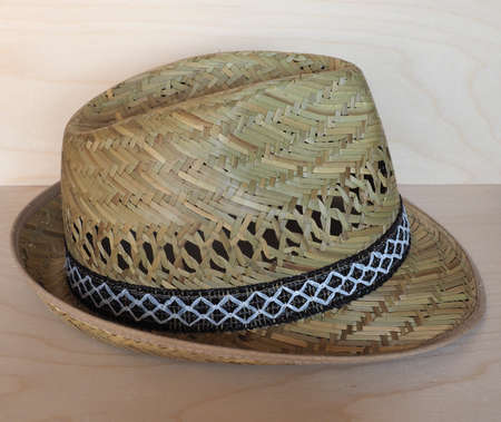 Brimmed straw hat woven out of straw
