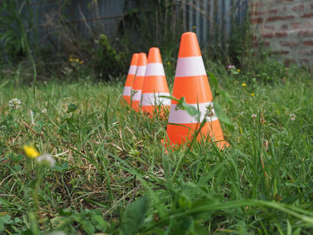 white and orange traffic cone to mark road works
