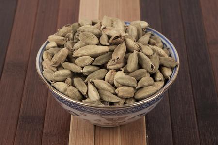 Cardamoms seeds in a bowl. Stok Fotoğraf