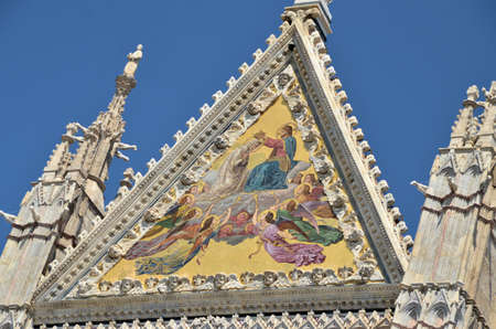 Architectural details of duomo cathedral in medieval town Siena, Tuscany, Italy photo