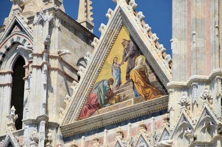 gargoyles: Architectural details of duomo cathedral in medieval town Siena, Tuscany, Italy Stock Photo
